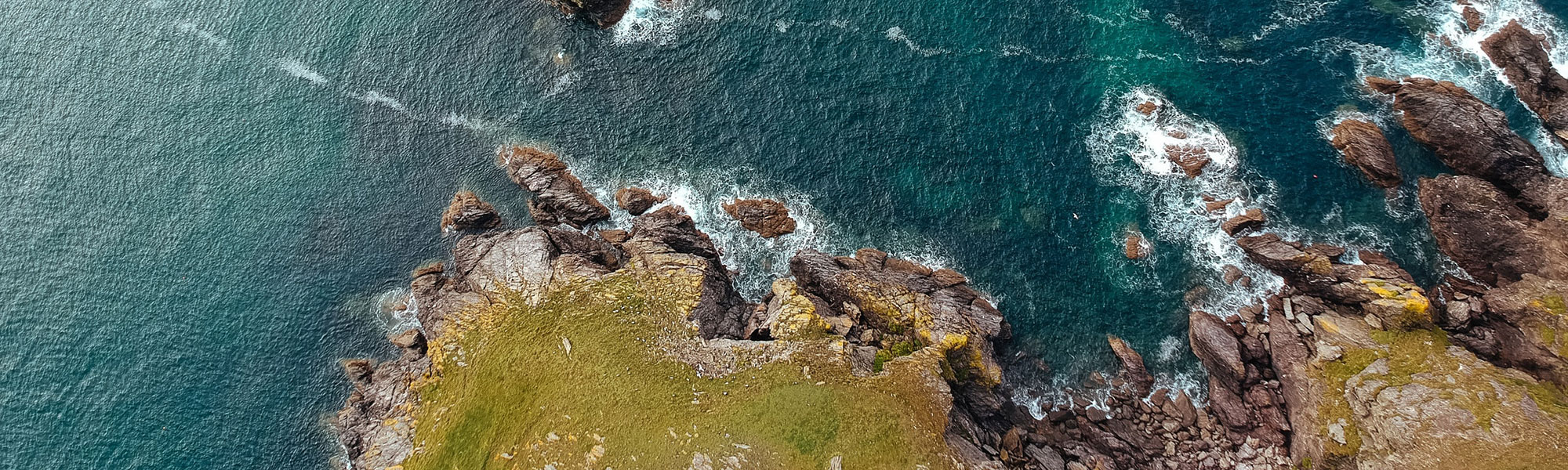 Birds eye of the coast line and ocean from above shot from a drone