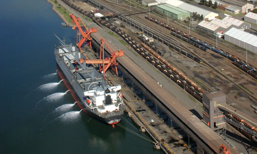 Ship in port discharging ballast water